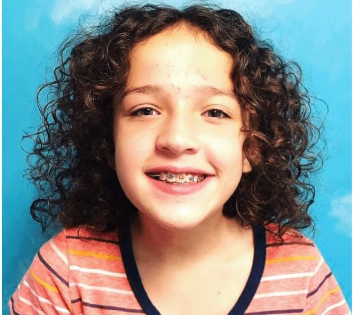 Curly haired girl with braces